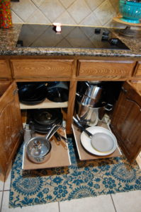 Sliding shelf for under the stove top