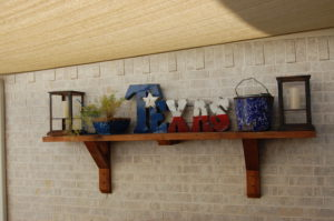 outdoor shelf on patio with Texas flare