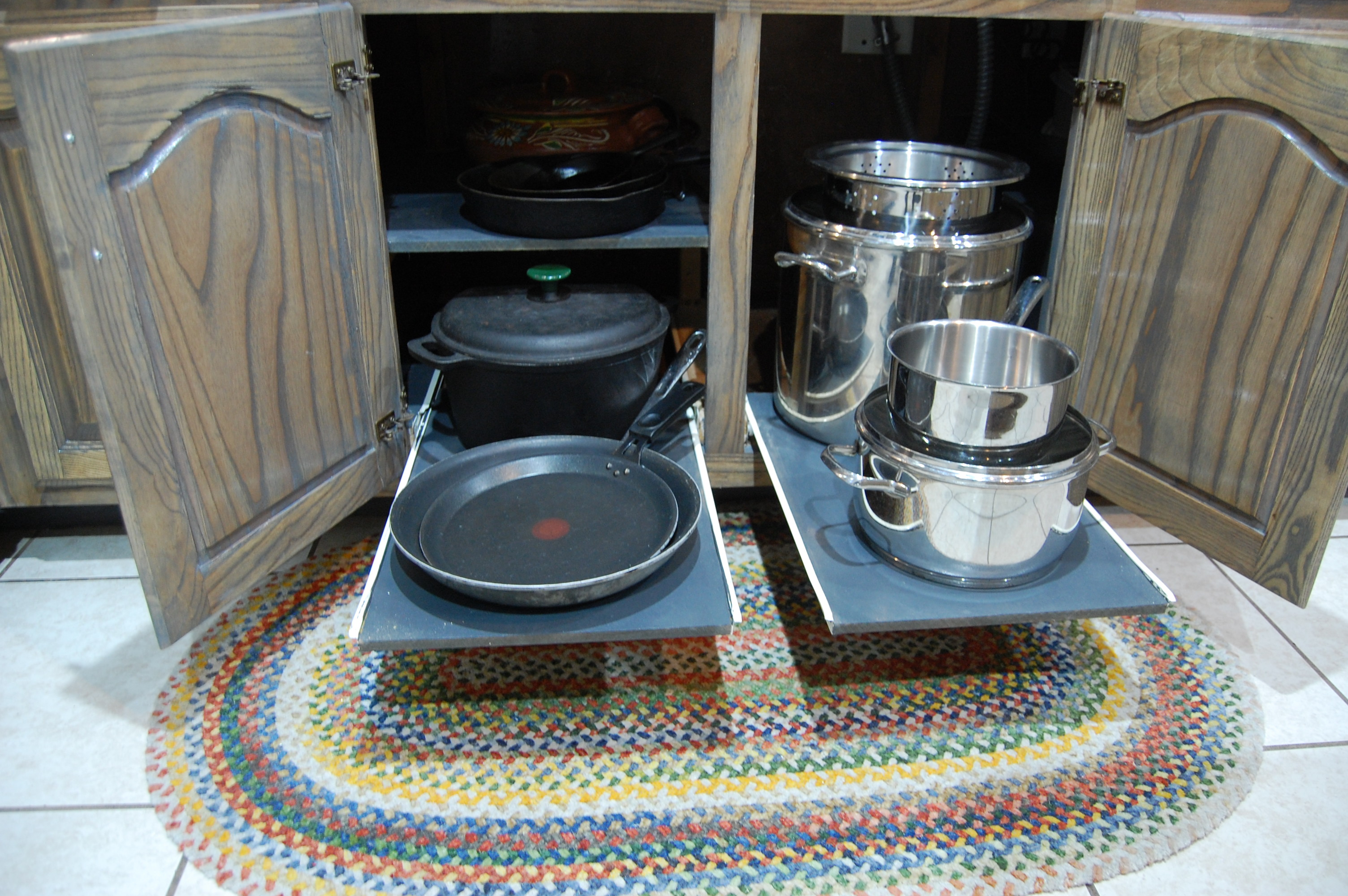 Under stove pull out shelves