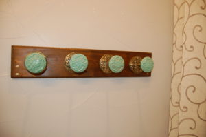 Tie backs for drapes are used to create this towel rack