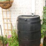 Rain barrels installed under gutter