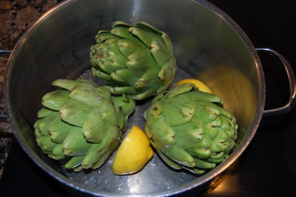 Boil artichokes with lemon