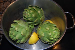 Boil artichokes with lemon