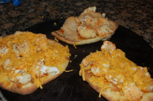 vegan buffalo cauliflower pizza or regular buffalo chicken pizza