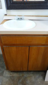 Old bathroom sink and vanity....ugly!