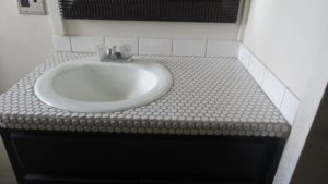 circular tiles were used to replace the formica top