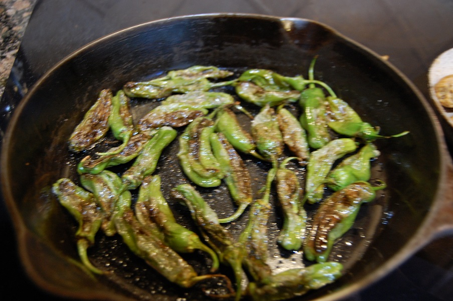 Shishito peppers cooking in pan