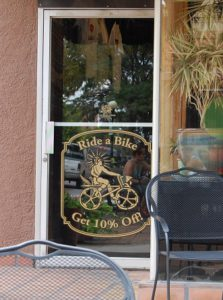 Solar roast coffee in downtown Pueblo - door coupon for riding bike