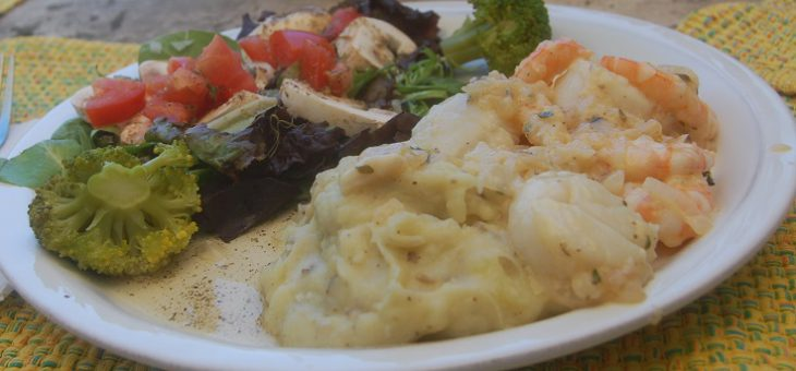 Elegant dinner of Seafood Provencal with vegan sides
