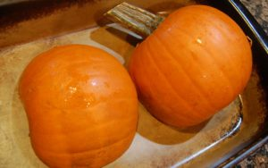 half cut pumpkin ready to roast