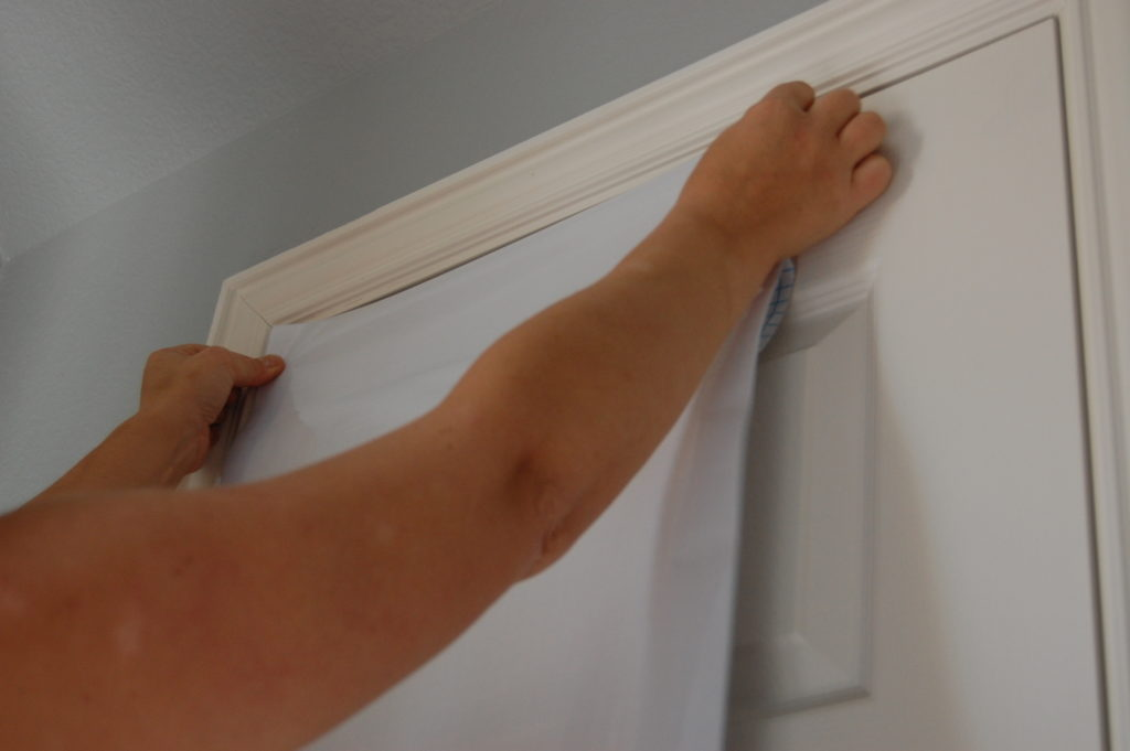Installing the dry erase paper