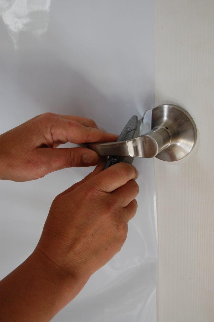 Use razor blade to cut around door handle